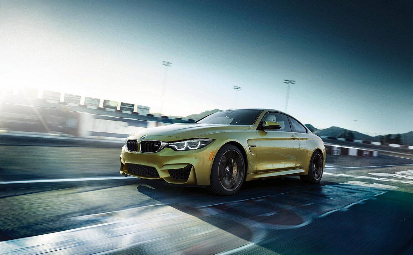 2018 BMW M4 Yellow Front Exterior Track