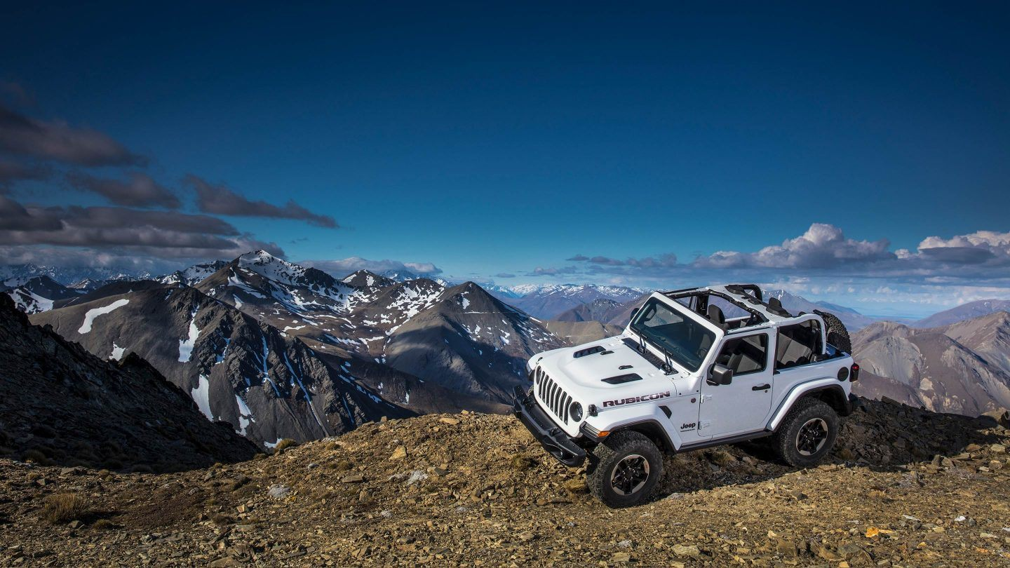 2018 Jeep Wrangler White Exterior Top and Side View