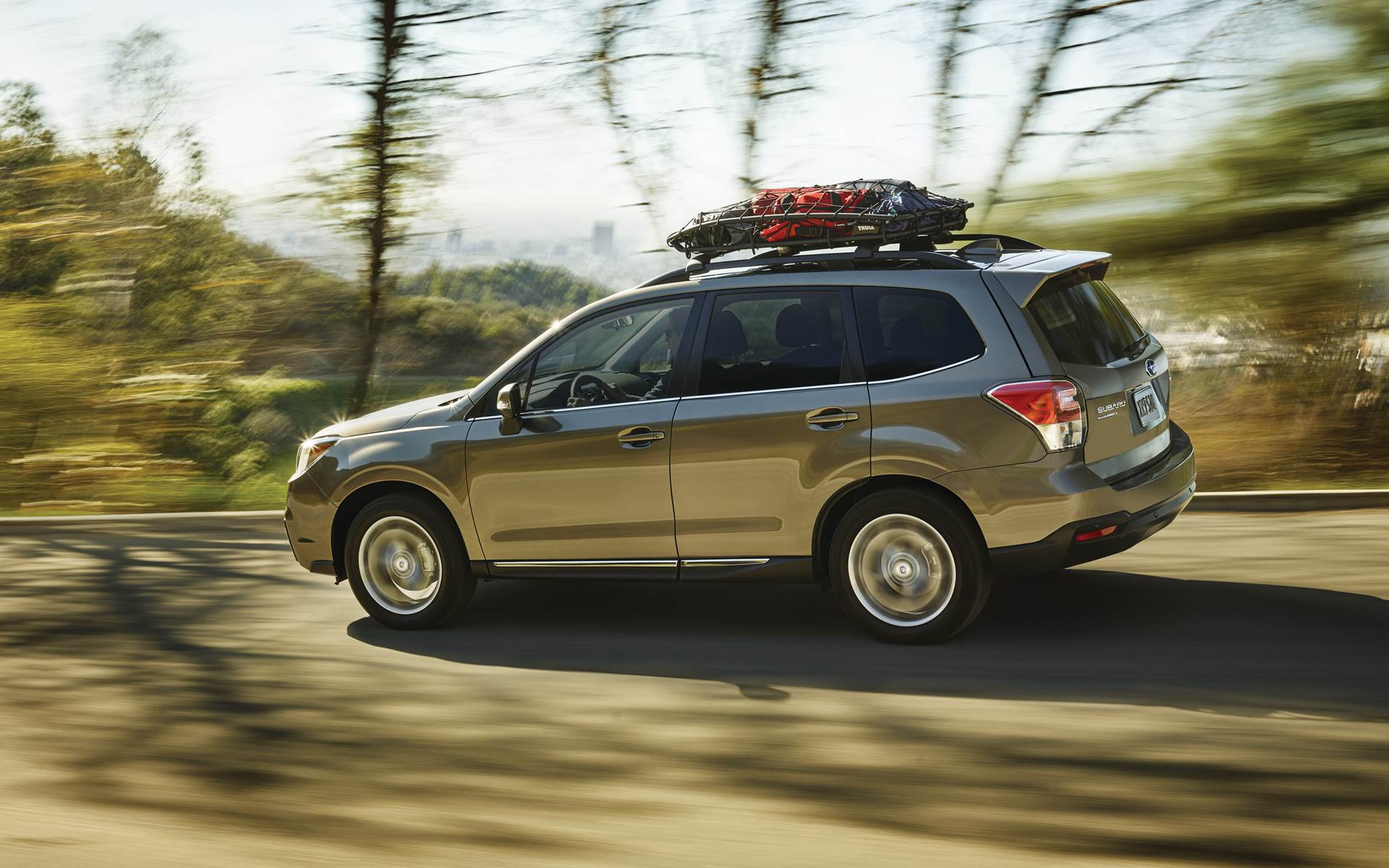 2018 Subaru Forester Sepia Bronze Exterior Side View Driving