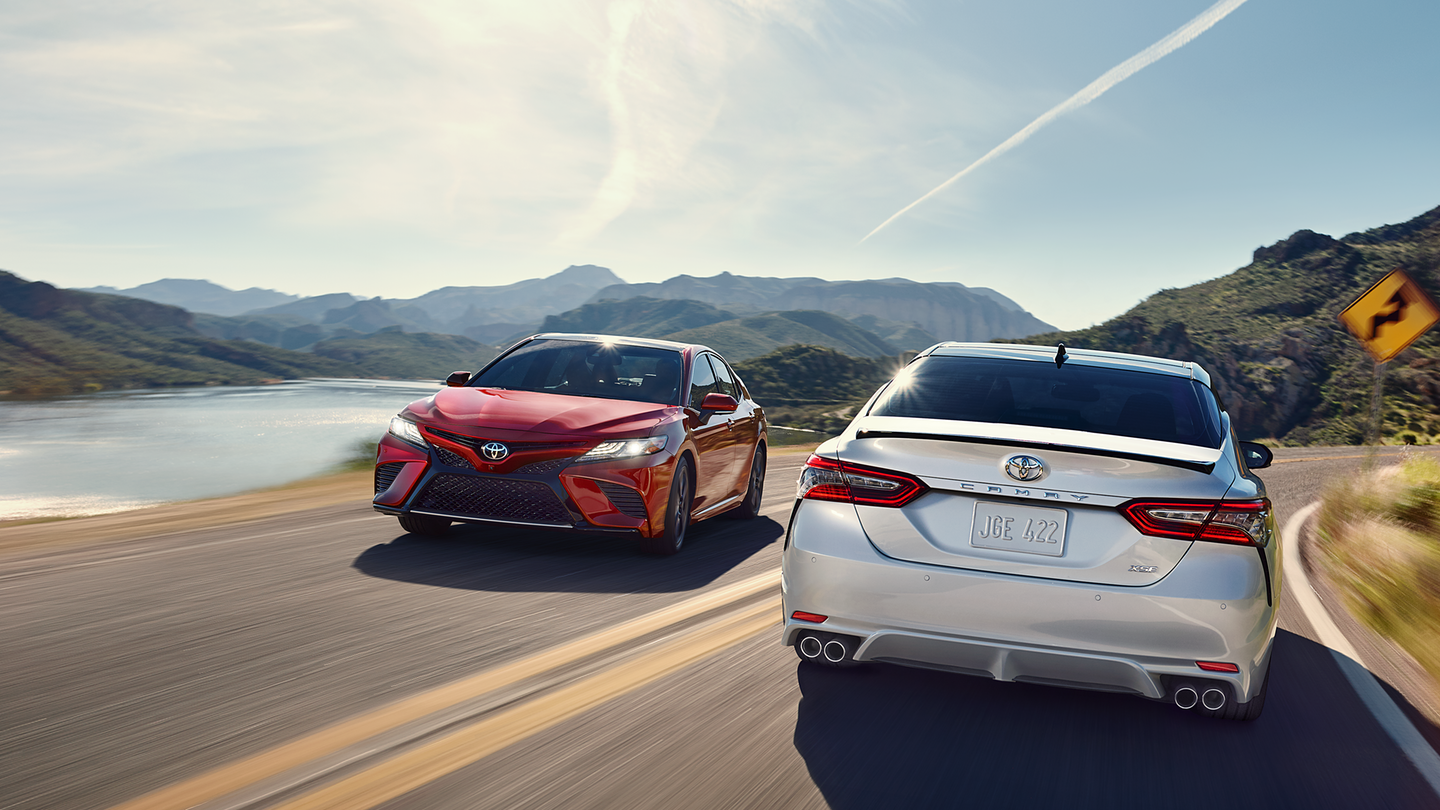 2018 Toyota Camry White Rear Exterior Red Front Exterior.png