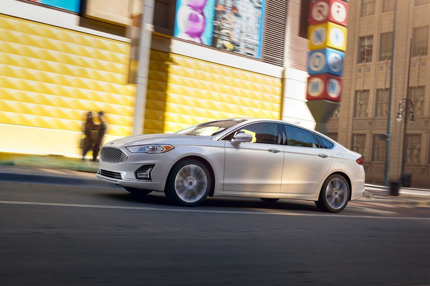 2019 Ford Fusion Driving White Exterior.jpeg