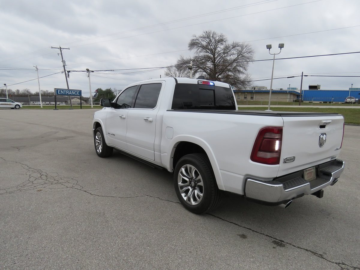 2019 Ram 1500 Laramie Longhorn with Police Upfit White Exterior Rear Picture